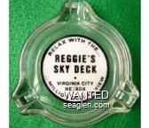 Relax With the … Reggie's Sky Deck, Virginia City, Nevada … Million Dollar View - Black on white imprint Glass Ashtray